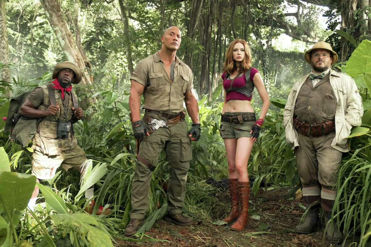 """In this image released by Sony Pictures shows, from left, Kevin Hart, Dwayne Johnson, Karen Gillan and Jack Black from the film, """"Jumanji: Welcome to the Jungle,"""" in theaters Dec. 20. (Frank Masi/Sony Pictures via AP)"""