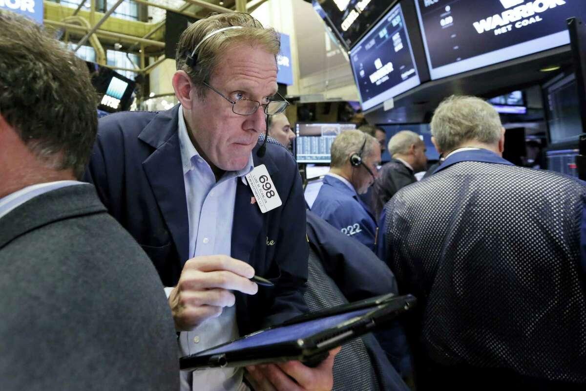 Trader Luke Scanlon works on the floor of the New York Stock Exchange Wednesday.