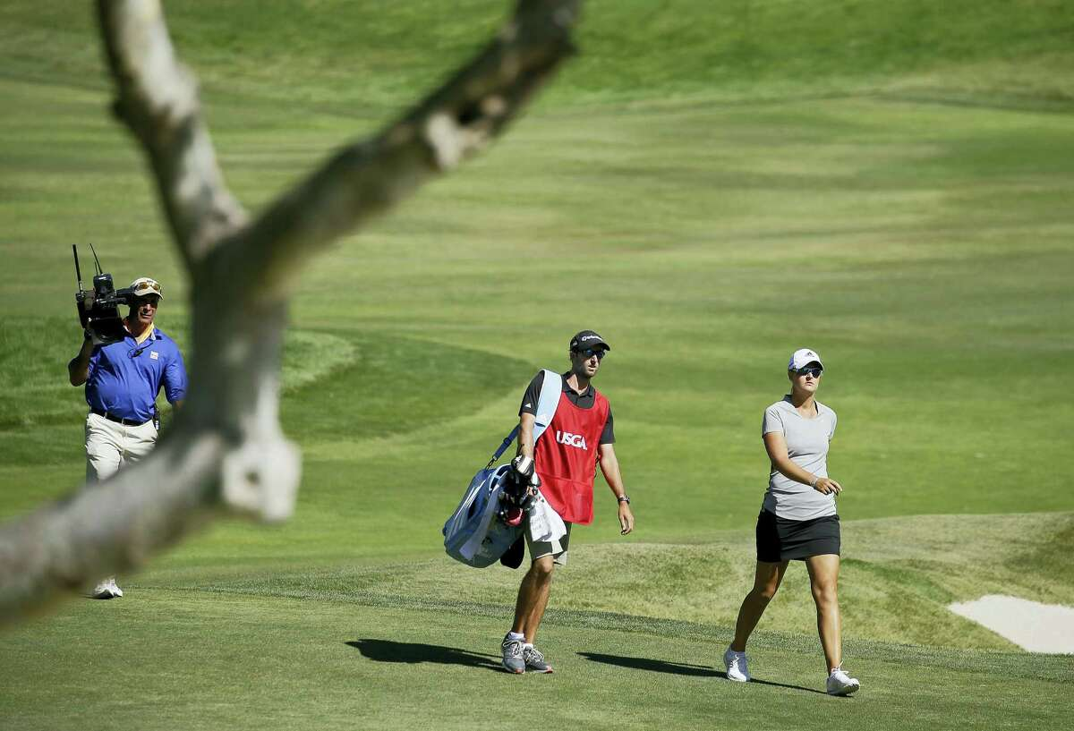 In this July 10, 2016 photo, Anna Nordqvist, of Sweden, walks to the green after hitting out of a bunker on the second playoff hole of the U.S. Women's Open golf tournament at CordeValle, in San Martin, Calif. Nordqvist was penalized for clipping sand during a bunker shot in the final round. Golf's ruling bodies issued a new guideline Tuesday that limits the use of video evidence in determining rules violations.
