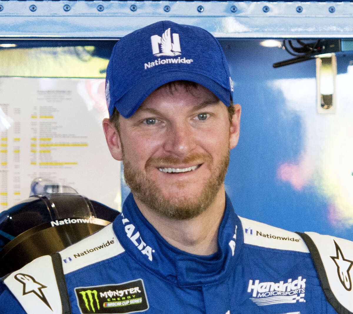 In this March 3, 2017 photo, Dale Earnhardt Jr. smiles in the garage during practice for the NASCAR Monster Energy Cup auto race at Atlanta Motor Speedway in Hampton, Ga. Hendrick Motorsports says Dale Earnhardt Jr. will retire at the end of this season.
