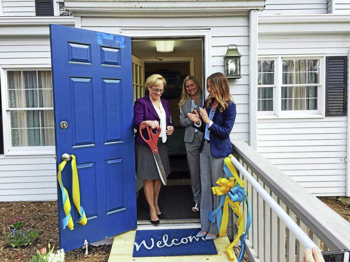The opening of Tides of Mind Counseling, a new mental health therapy practice in Torrington, was celebrated Thursday with a ribbon-cutting ceremony. From left are Mayor Elinor Carbone,