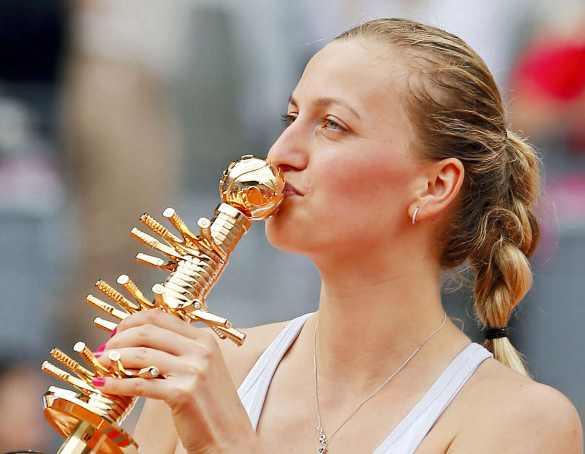 Petra Kvitova of the Czech Republic kisses the trophy after defeating Svetlana Kuznetsova of Russia in their women's singles final match at the Madrid Open Tennis tournament in Madrid, Spain on May 9, 2015.