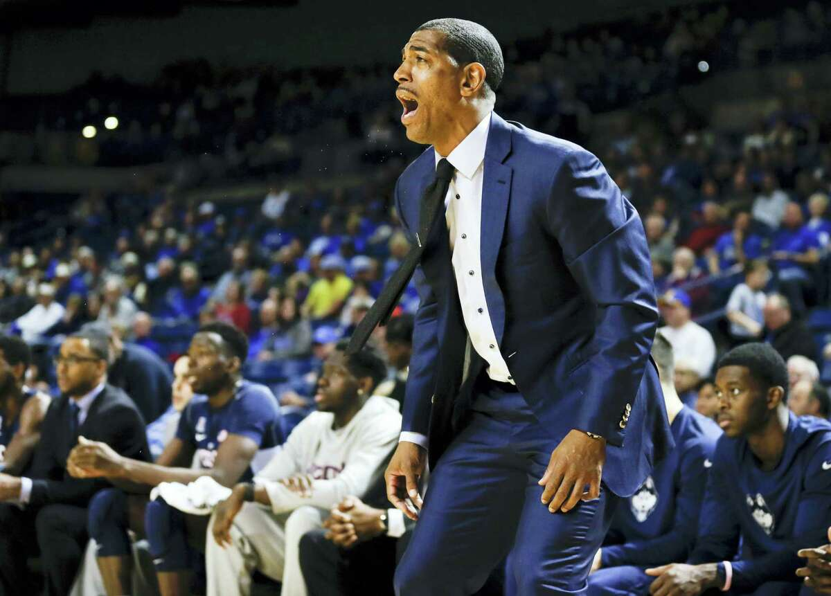 UConn men's basketball coach, Kevin Ollie yells to his players from the sidelines in the first half against Tulsa. The Huskies play at Memphis Thursday.