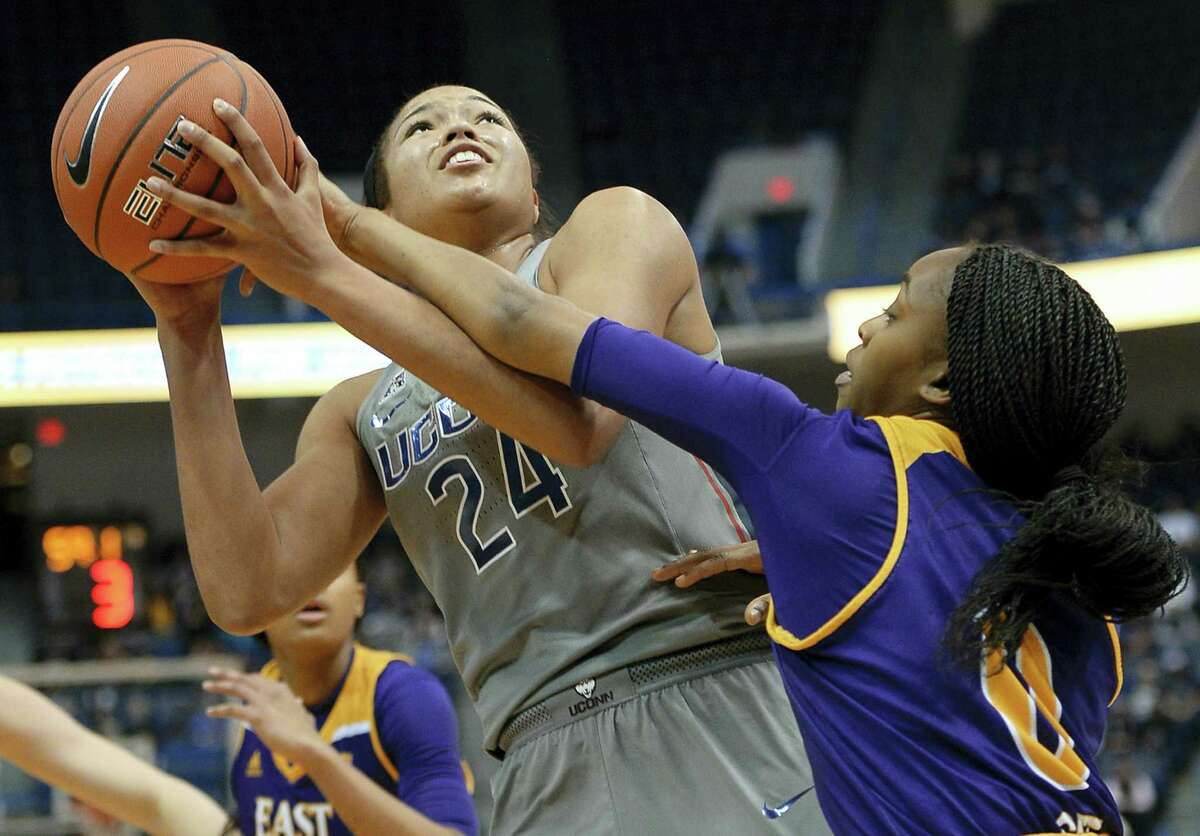 UConn's Napheesa Collier is fouled by East Carolina's JusticeGee, right, in the first half of UConn's 89th consecutive victory Wednesday night, 90-45 over East Carolina.