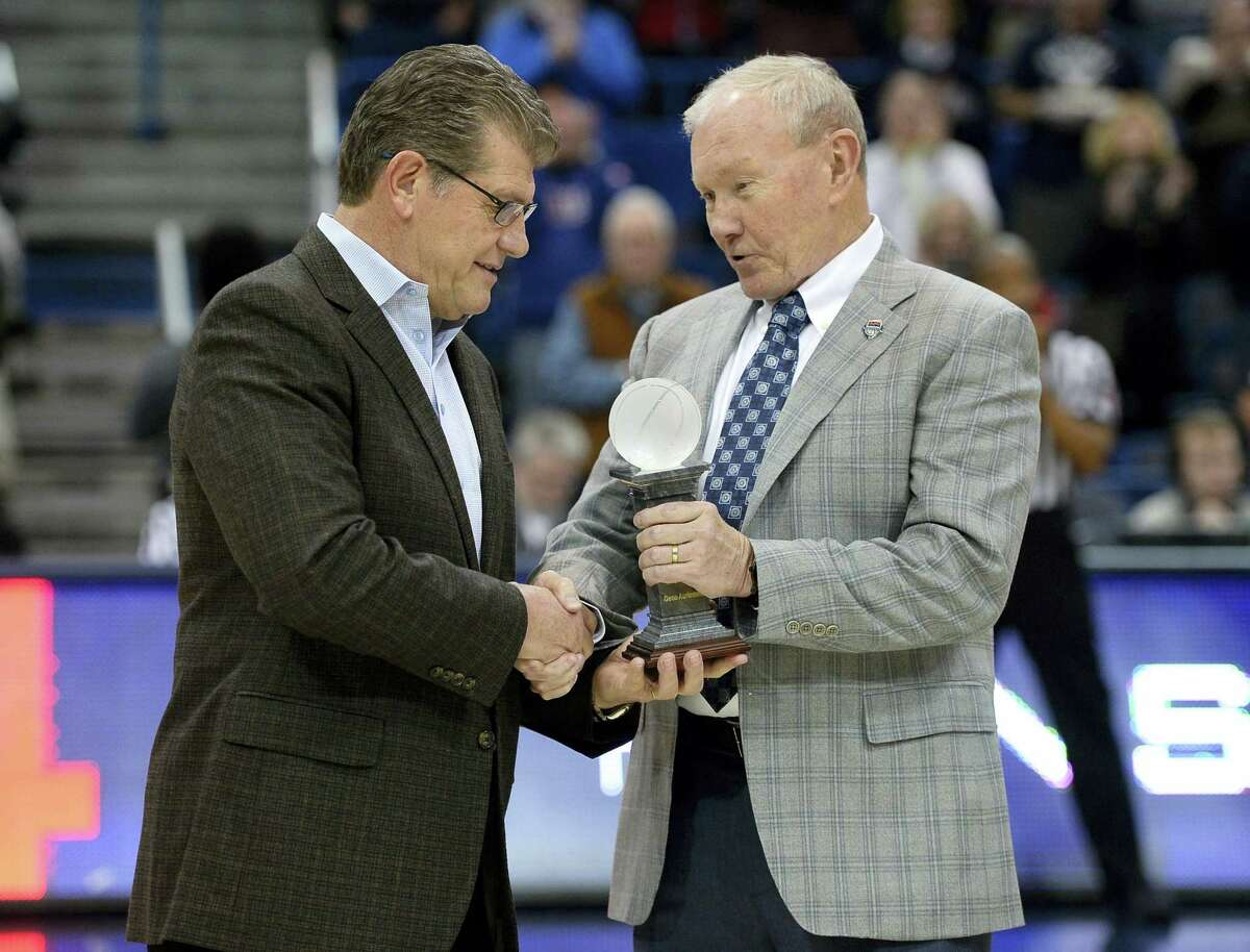 UConn head coach Geno Auriemma is presented with the USA Basketball coach of the year award by USA Basketball chairman, retired Gen. Martin E. Dempsey, before Wednesday's game against East Carolina.
