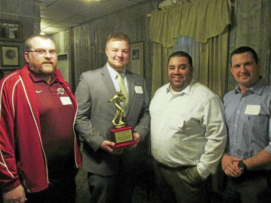 Torrington football's '29 Club Trophy winner Andrew Shimanski stands with, from left, Line Coach Andy Theriault, head coach Gaitan Rodriguez and club president Mike Ciesco. Photo: Photo By Peter Wallace