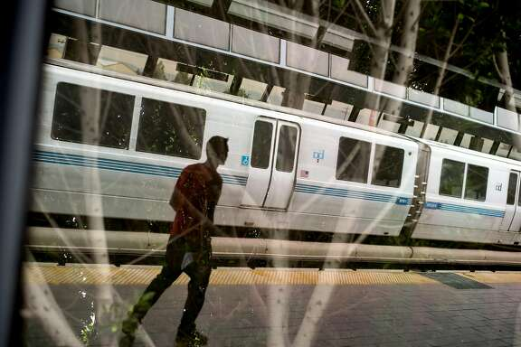 A BART rider crosses a platform at the Fruitvale station on Friday, Aug. 4, 2017, in Oakland, Calif.
