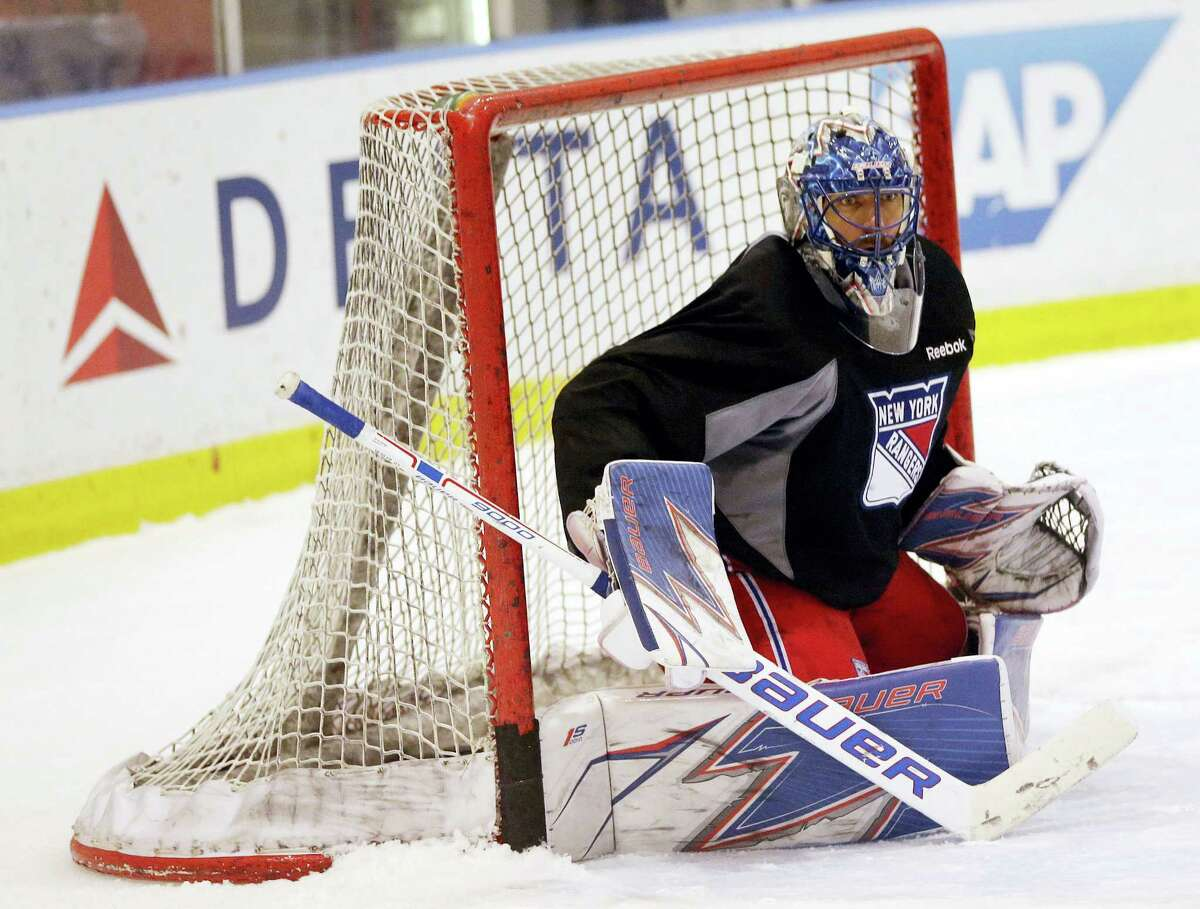 New York Rangers goalie Henrik Lundqvist covers the net during NHL hockey practice in Tarrytown, N.Y., Tuesday. The Rangers face the Ottawa Senators in the second round of the Stanley Cup playoffs beginning Thursday.