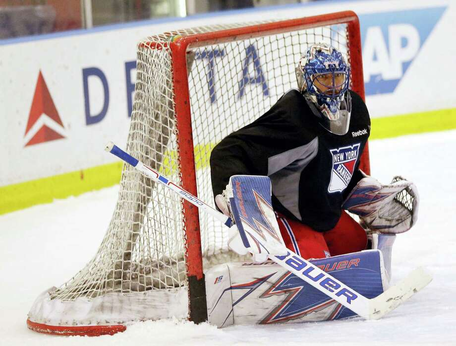 New York Rangers goalie Henrik Lundqvist covers the net during NHL hockey practice in Tarrytown, N.Y., Tuesday. The Rangers face the Ottawa Senators in the second round of the Stanley Cup playoffs beginning Thursday. Photo: SETH WENIG — THE ASSOCIATED PRESS  / Copyright 2017 The Associated Press. All rights reserved.
