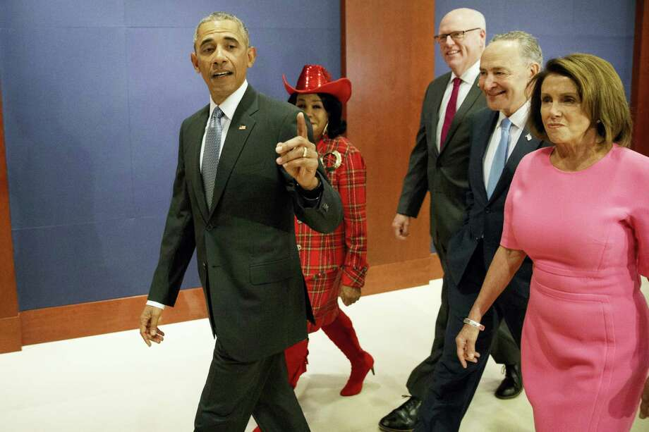 President Barack Obama, joined by, from second from left, Rep. Frederica Wilson, D-Fla., Rep. Joseph Crowley, D-N.Y., Senate Minority Leader Charles Schumer of N.Y., and House Minority Leader Nancy Pelosi of Calif. arrives on Capitol Hill in Washington on Jan. 4, 2017 to meet with members of Congress to discuss his signature healthcare law. Photo: AP Photo/Evan Vucci  / Copyright 2017 The Associated Press. All rights reserved.