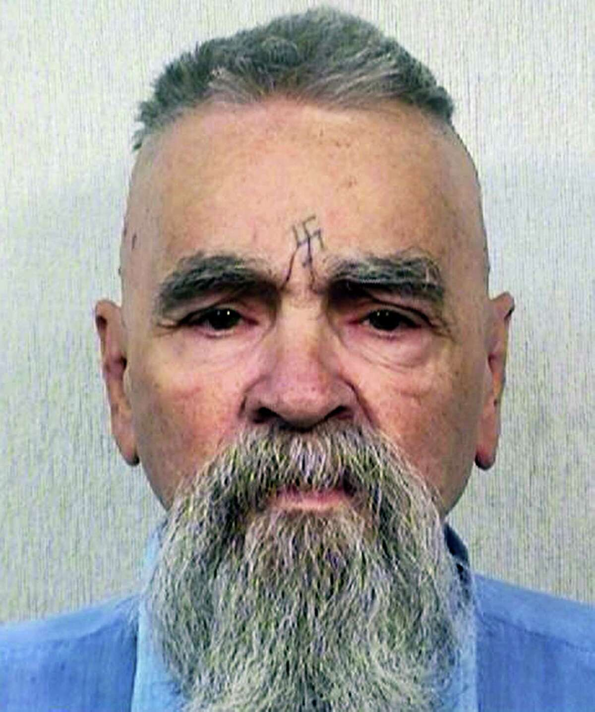 This Oct. 8, 2014, file photo provided by the California Department of Corrections and Rehabilitation shows serial killer Charles Manson. California prison official says cult killer Manson is alive following reports that he was hospitalized on Tuesday, Jan. 3, 2017.