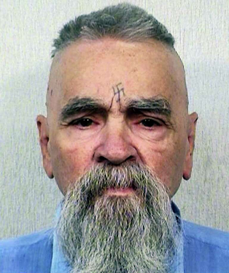 This Oct. 8, 2014, file photo provided by the California Department of Corrections and Rehabilitation shows serial killer Charles Manson. California prison official says cult killer Manson is alive following reports that he was hospitalized on Tuesday, Jan. 3, 2017. Photo: California Department Of Corrections And Rehabilitation Via AP, File  / California Department of Corrections and Rehabilitation