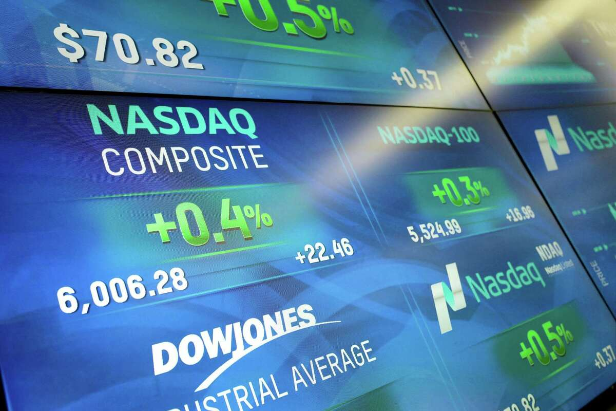 Electronic screens display stock index values at the Nasdaq MarketSite Tuesday in New York.