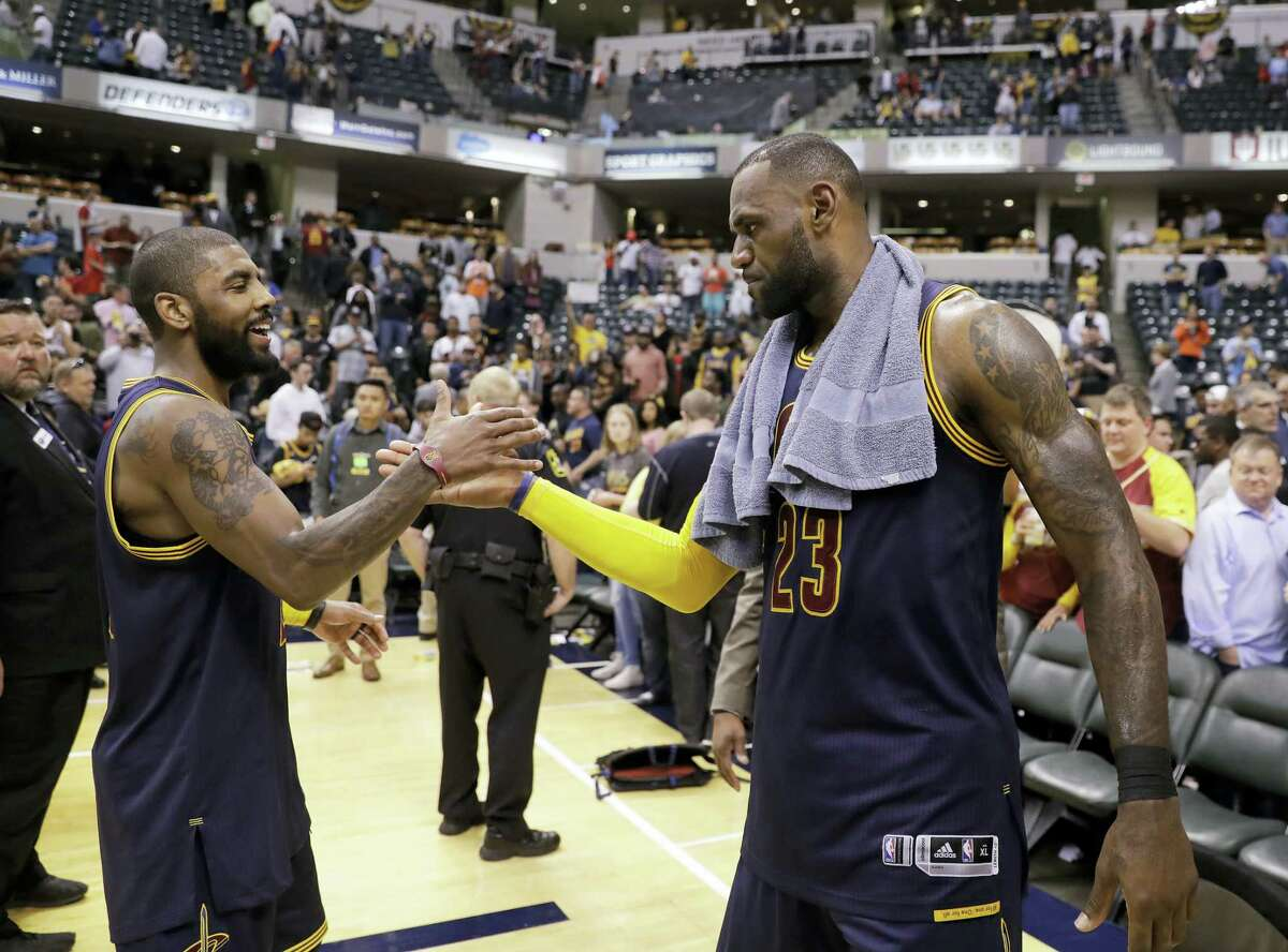 Cleveland Cavaliers' LeBron James, right, and Kyrie Irving celebrate after Cleveland defeated the Indiana Pacers 106-102 to win Game 4 of a first-round NBA basketball playoff series on April 23, 2017 in Indianapolis. Cleveland won the series 4-0.