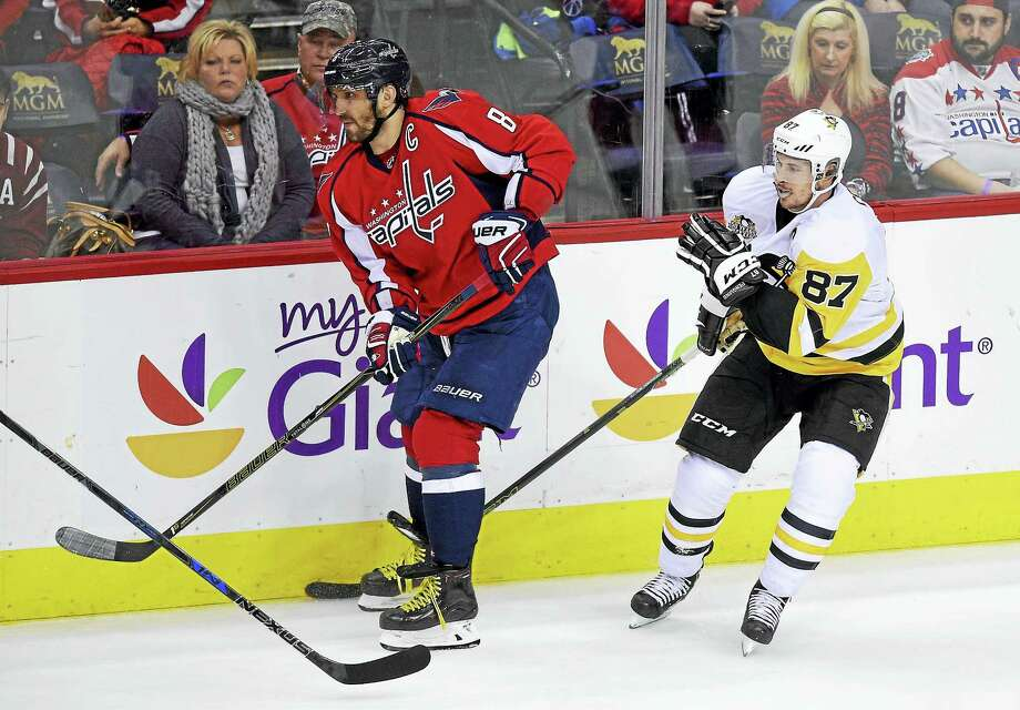 Washington Capitals left wing Alex Ovechkin (8), skates in front of Penguins center Sidney Crosby. Photo: The Associated Press File Photo  / FR67404 AP