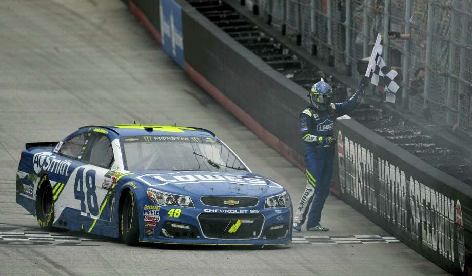 Jimmie Johnson celebrates his win at Bristol Motor Speedway on Monday Photo: Andre Teague — The Bristol Herald-Courier Via AP  / The Bristol Herald-Courier