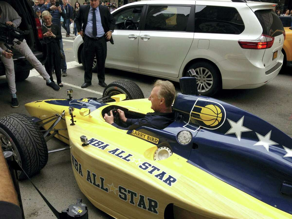 Indiana Pacers president Larry Bird sits in an Indy car in New York, Monday. Bird drove four blocks down Fifth Avenue in the car to deliver the basketball team's bid to host the 2021 game to NBA Commissioner Adam Silver.