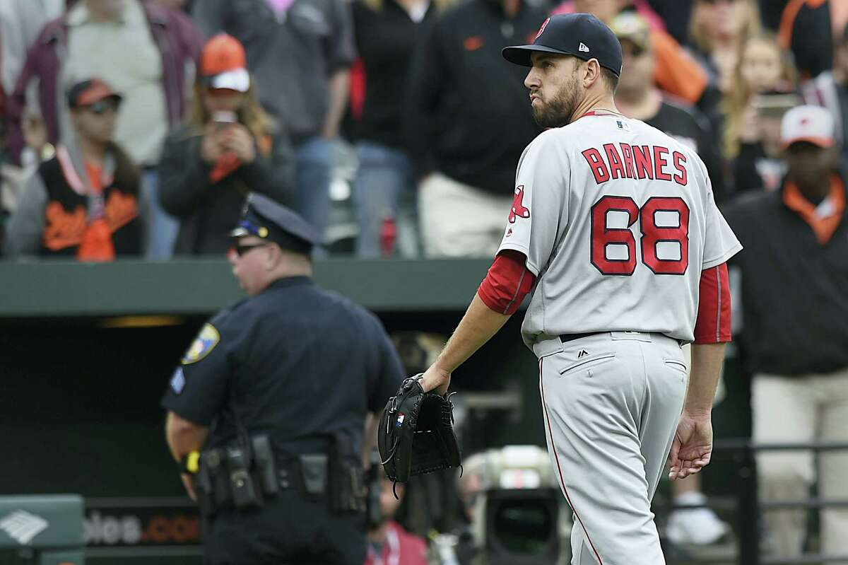 Red Sox pitcher Matt Barnes walks off the field after being ejected for throwing at Manny Machado on Sunday.