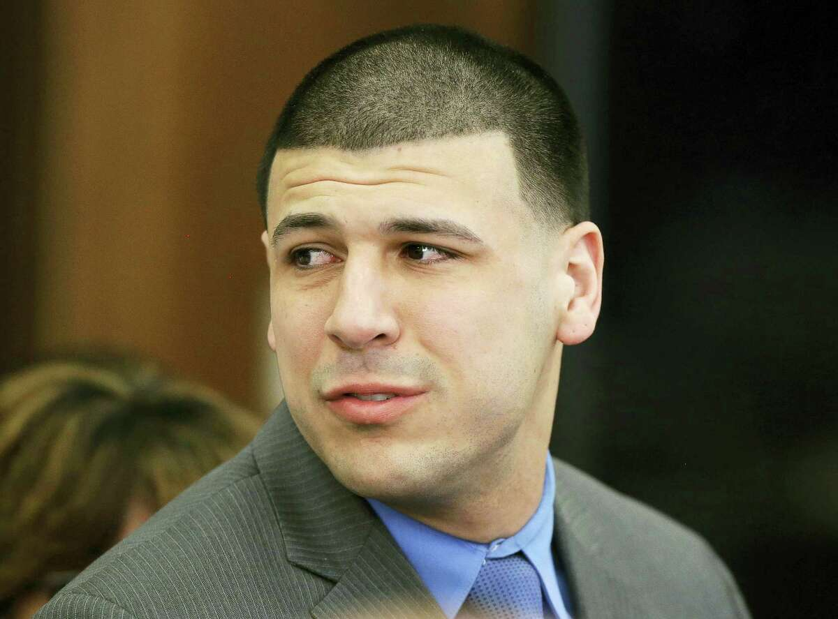 In this Friday, April 14, 2017 photo, Former New England Patriots tight end Aaron Hernandez turns to look toward his fiancee Shayanna Jenkins Hernandez as he reacts to his double murder acquittal at Suffolk Superior Court in Boston. Hernandez's family is planning a private funeral for the former NFL star in his hometown in Bristol, Conn. A spokeswoman for the Connecticut Funeral Directors Association said Saturday, April 22, that the service is set for Monday, April 24. The former New England Patriots tight end was found hanged in his cell in a maximum-security prison in Massachusetts early Wednesday, April 19.