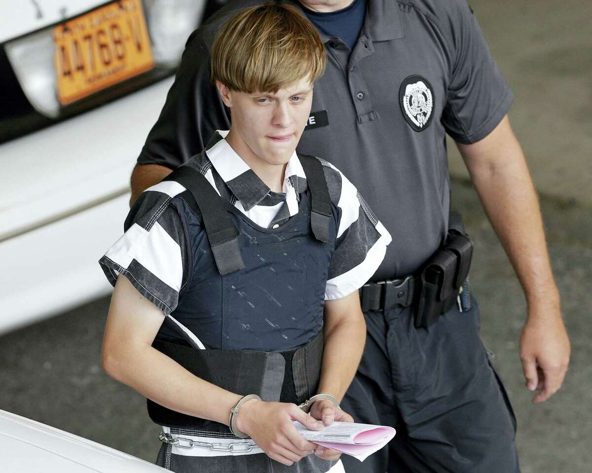 Shooting suspect Dylann Storm Roof is escorted from the Cleveland County Courthouse in Shelby, N.C. in 2015