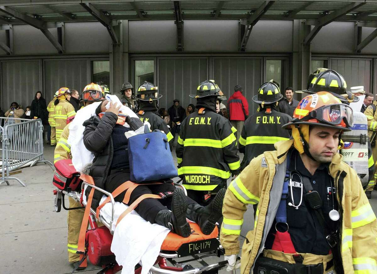 An injured passenger is taken from Atlantic Terminal in the Brooklyn borough of New York after a Long Island Rail Road train hit a bumping block, Wednesday, Jan. 4, 2017.