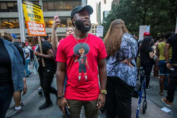 Participants during a rally in support of Colin Kaepernick, the former NFL quarterback, outside the league�s headquarters on Park Avenue in Manhattan, Aug. 23, 2017. Kaepernick�s protests of police brutality and racial oppression have made him one of the most talked-about players of the upcoming football season, even without a team. (Hiroko Masuike/The New York Times)