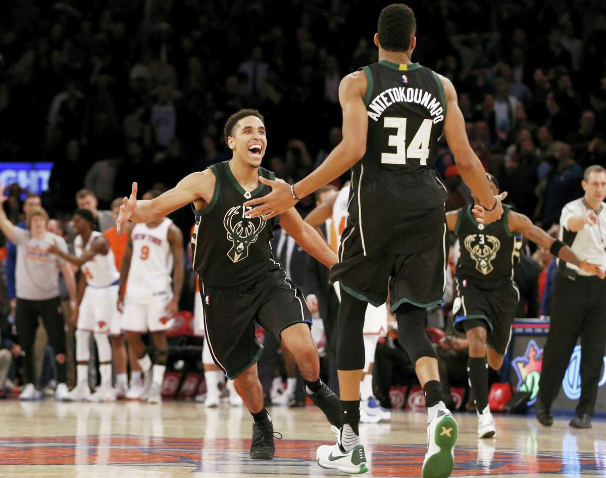 Milwaukee Bucks' guard Malcolm Brogdon (13) reacts as he runs toward Milwaukee Bucks' forward Giannis Antetokounmpo (34) who hit a buzzer-beater to defeat the New York Knicks in the waning seconds of an NBA basketball game at Madison Square Garden in New York, Wednesday, Jan. 4, 2017. The Bucks defeated the Knicks 105-104 on Antetokounmpo's shot. (AP Photo/Kathy Willens)
