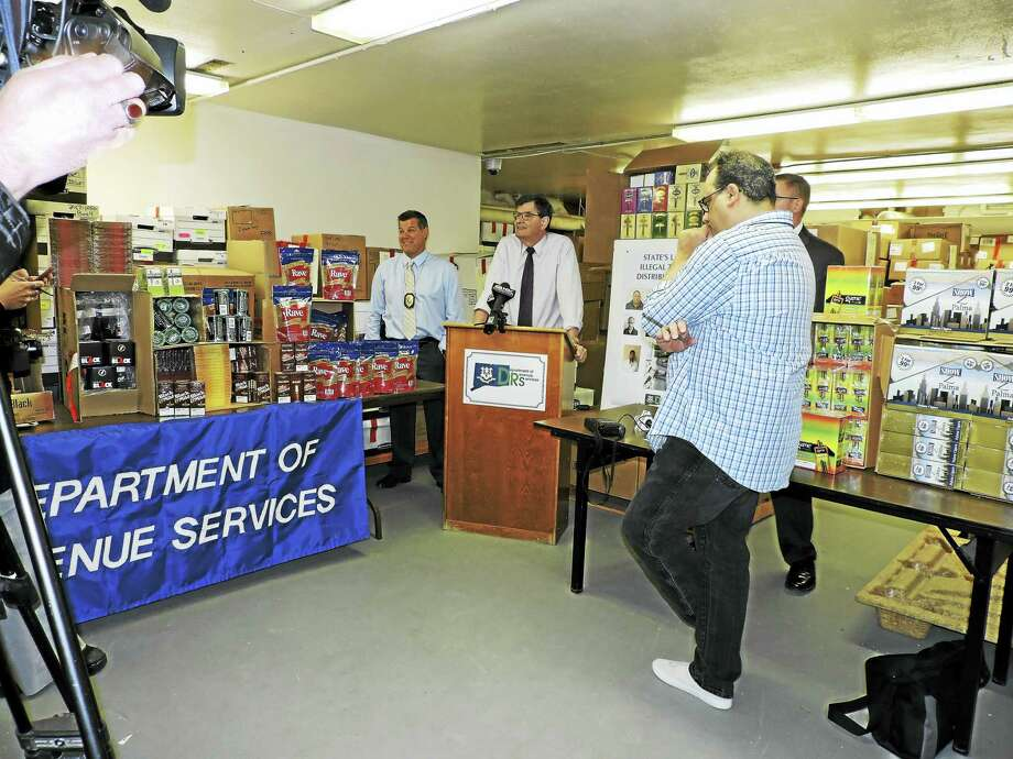 Connecticut Commissioner of Revenue Services Kevin Sullivan announced the results of a five-month investigation that led to the arrest of 10 people as well as the seizure of more than $50,000 in cash and $234,000 in contraband tobacco from a Bridgeport tobacco wholesaler. Photo: Courtesy Of Department Of Revenue Services