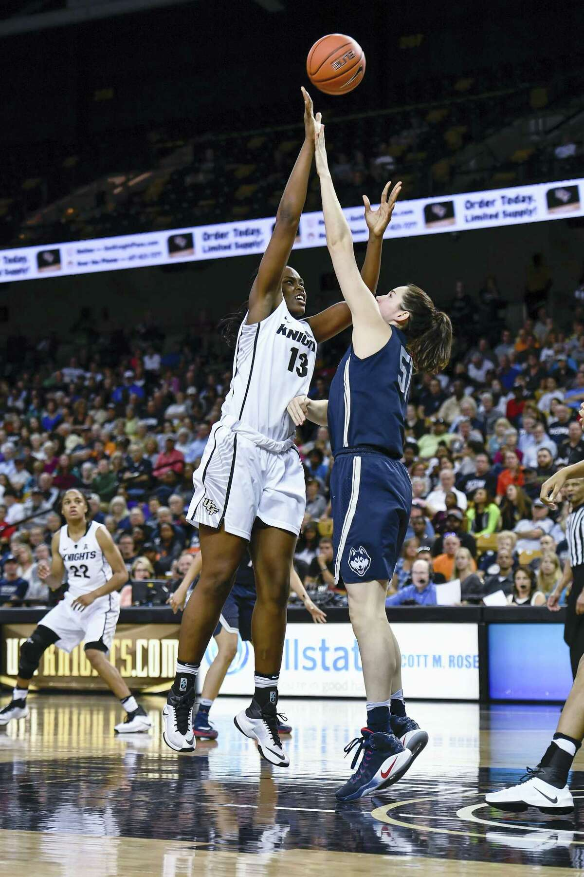 Central Florida center Kayla Thomas shoots over UConn center Natalie Butler during an NCAA college basketball game, Sunday in Orlando, Fla. Butler is averaging 6.4 points and 4.6 rebounds per game for the Huskies.