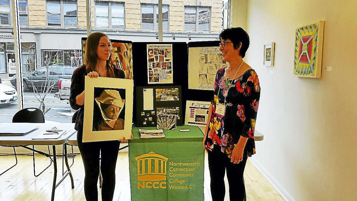 Kristin Smith, 18, of Hartland shows her art to Janet Nesteruk, art professor at Northwestern Connecticut Community College in Winsted at the third annual Portfolio Day at Five Points Gallery.