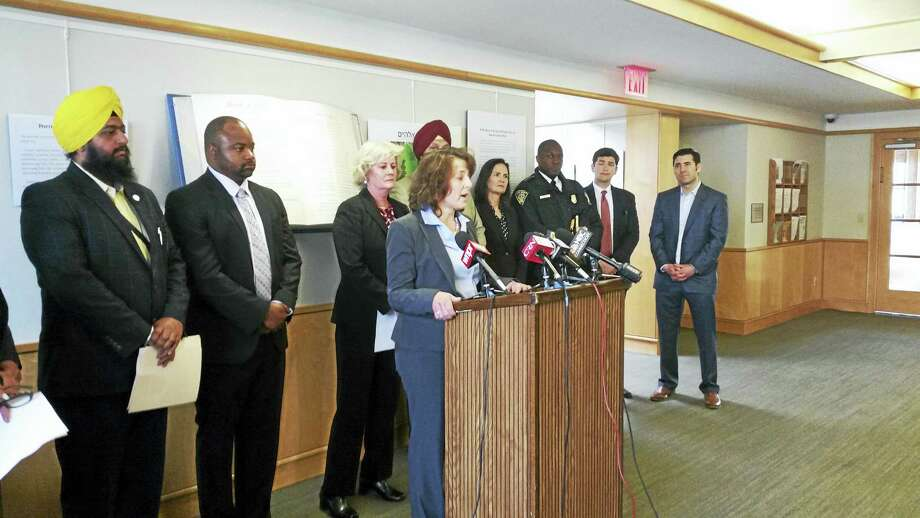 Judy Alperin, chief executive officer of the Jewish Federation of Greater New Haven, speaks at Congregation Beth El-Keser Israel about increased incidents of violence. Photo: Jessica Lerner — New Haven Register