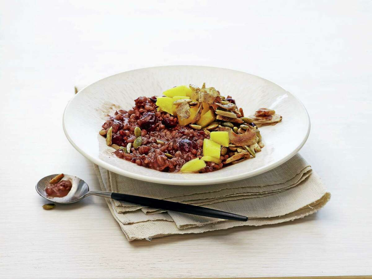 Red rice and barley congee with mango and coconut