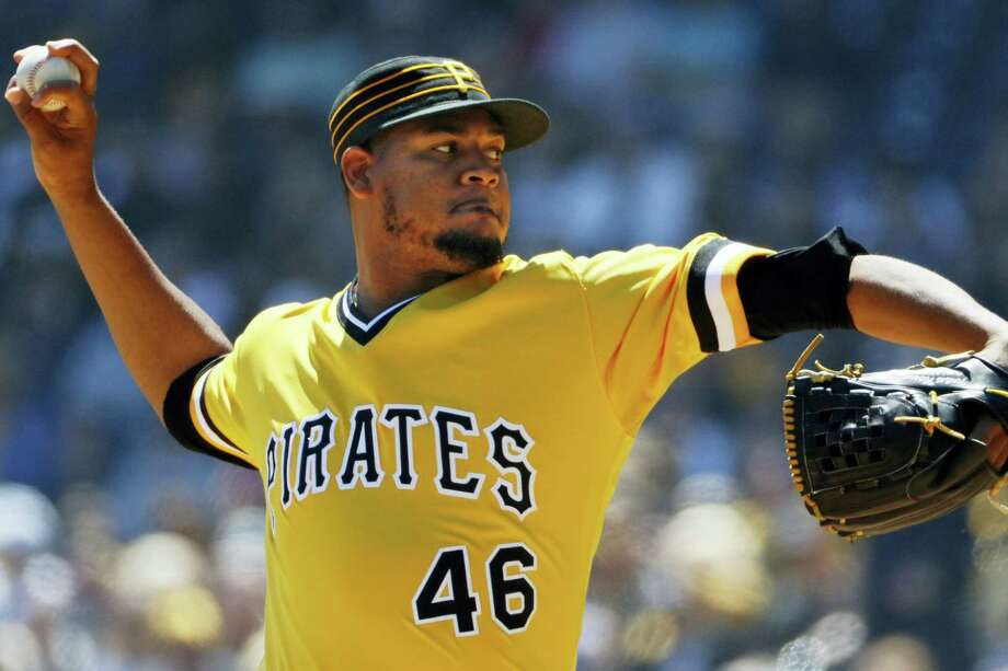 Pirates starting pitcher Ivan Nova delivers during the first inning Sunday. Photo: Gene J. Puskar — The Associated Press  / Copyright 2017 The Associated Press. All rights reserved.