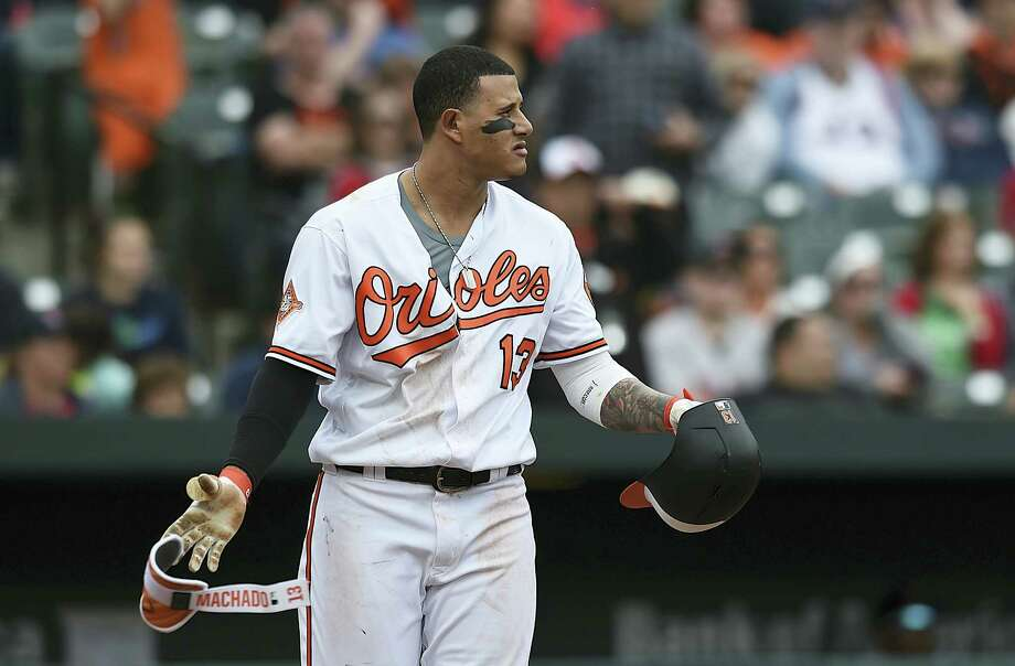 The Orioles Manny Machado looks to the mound after a pitch was thrown near his head by Matt Barnes in the eighth inning Sunday. Photo: Gail Burton — The Associated Press  / FR4095 AP