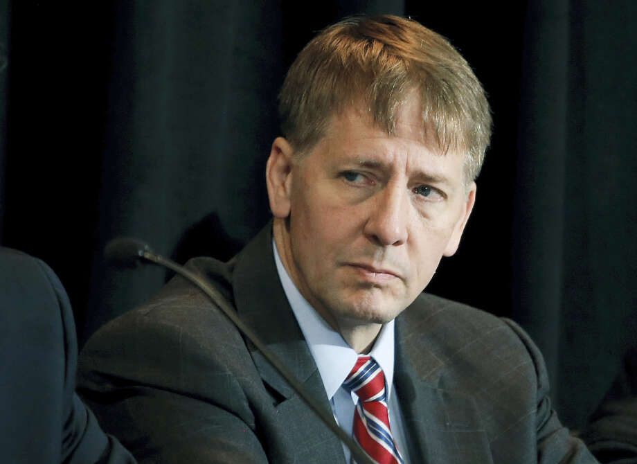 In this Oct. 7, 201 photo, Consumer Financial Protection Bureau Director Richard Cordray listens to a speaker during a a hearing in Denver. Americans lodged nearly 300,000 complaints last year about their dealings with banks, credit card issuers and other financial services companies, most compiled and made readily available for anyone to see as part of a database administered by the federal government. But that window may soon be closing. Photo: AP Photo — Brennan Linsley, File  / Copyright 2017 The Associated Press. All rights reserved.