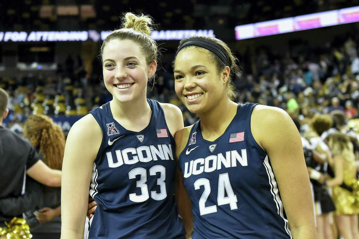 Connecticut's Katie Lou Samuelson (33) and forward Napheesa Collier (24) wait to speak to the media following an NCAA college basketball game on Jan. 1, 2017 in Orlando, Fla. Connecticut defeated UCF 84-48.