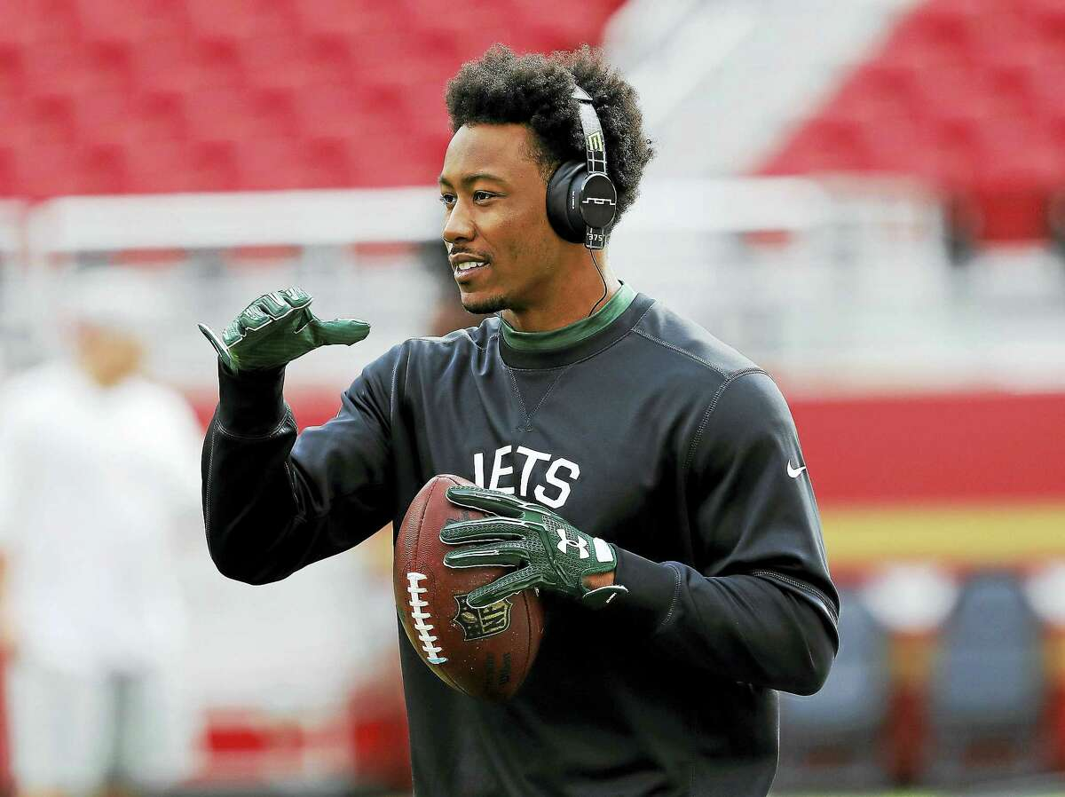 Jets wide receiver Brandon Marshall warms up before a game this season.