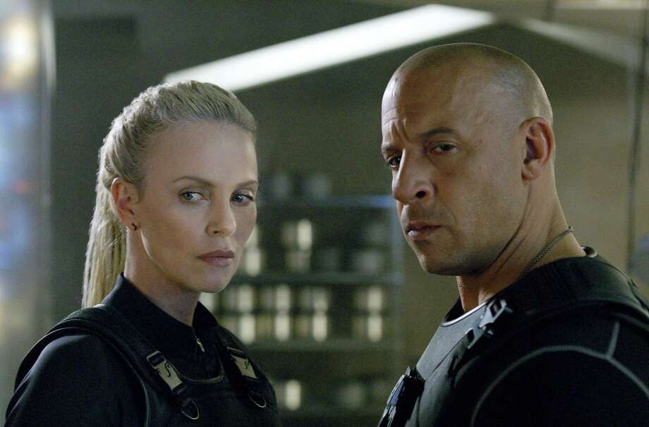 """This image released by Universal Pictures shows Charlize Theron, left, and Vin Diesel in """"The Fate of the Furious."""" (Universal Pictures via AP) Photo: AP / Copyright: © 2017 Universal Studios. ALL RIGHTS RESERVED."""