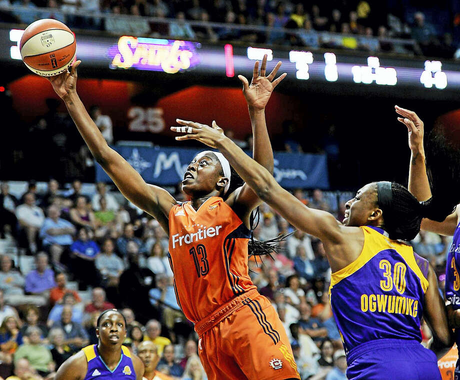 The Connecticut Sun's Chiney Ogwumike, left, shoots past the Sparks' Nneka Ogwumike during a WNBA game. Photo: Jessica Hill — The Associated Press File Photo  / AP2016