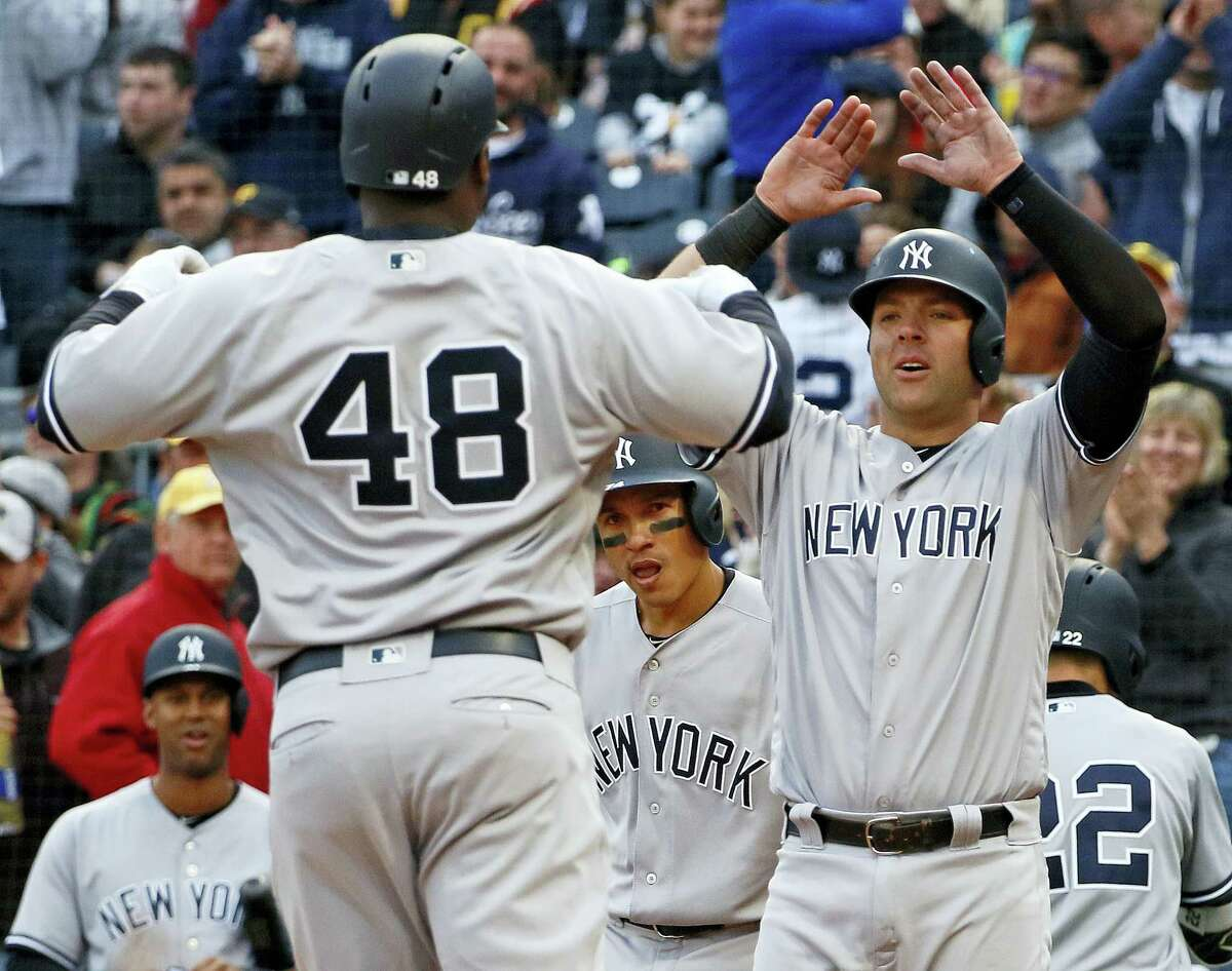 The Yankees' Chris Carter (48) celebrates with Austin Romine, right, after hitting a home run in the eighth inning on Saturday.
