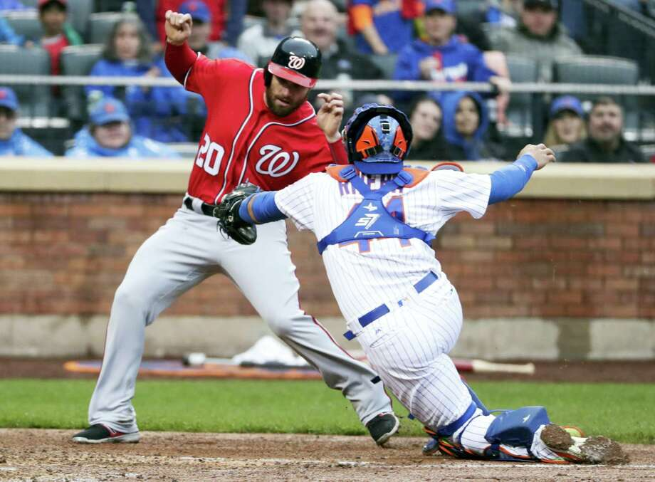 The Nationals' Daniel Murphy (20) evades a tag by Mets catcher Rene Rivera during the fourth inning. Photo: Frank Franklin II — The Associated Press  / Copyright 2017 The Associated Press. All rights reserved.