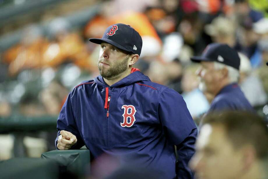 Dustin Pedroia stands in the dugout in the third inning Saturday. Photo: Patrick Semansky — The Associated Press  / Copyright 2017 The Associated Press. All rights reserved.