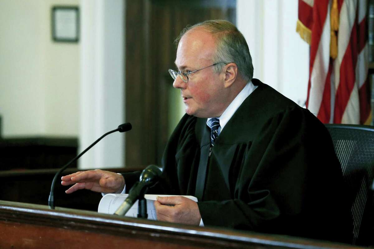 Judge Thomas F. McGuire Jr. addresses attorney George Leontire, representing the family of Aaron Hernandez, and attorney Mary Murray, representing the Department of Corrections, at Bristol Superior Court on Friday, April 21, 2017, in New Bedford, Mass. Judge McGuire on Friday ordered key evidence in the prison suicide of Aaron Hernandez preserved, granting a request from the ex-NFL star's fiancee so the family can investigate the circumstances of his death.