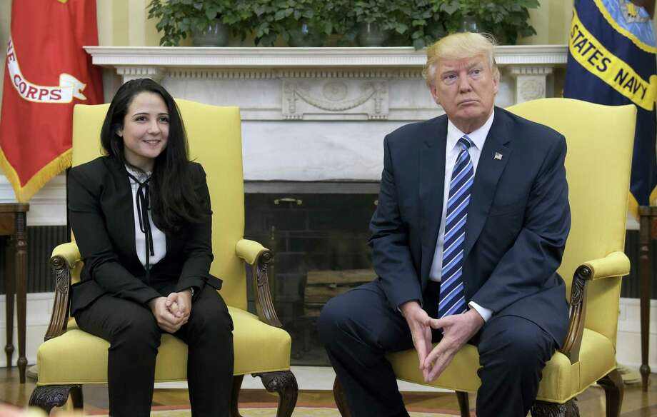President Donald Trump meets with Aya Hijazi, an Egyptian-American aid worker, in the Oval office of the White House in Washington, Friday, April 21, 2017. Hijazi, an Egyptian-American charity worker, was freed after nearly three years of detention in Egypt returning to the U.S., Thursday, April 20, 2017. Photo: AP Photo/Susan Walsh   / Copyright 2017 The Associated Press. All rights reserved.
