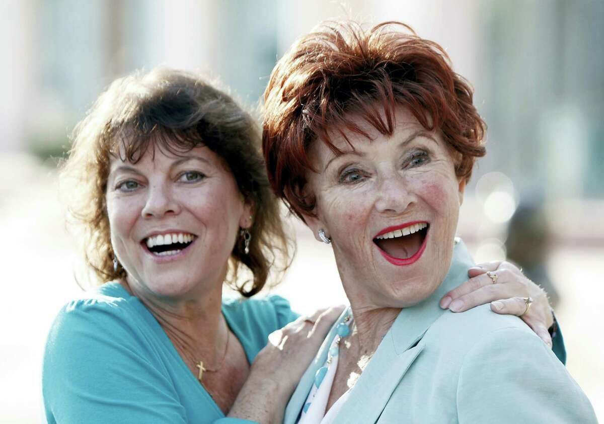 """In this June 18, 2009 file photo, actresses Erin Moran, left, and Marion Ross pose together at the Academy of Television Arts and Sciences' """"A Father's Day Salute to TV Dads"""" in the North Hollywood section of Los Angeles. Moran, the former child star who played Joanie Cunningham in the sitcoms """"Happy Days"""" and """"Joanie Loves Chachi,"""" has died at age 56. Police in Harrison County, Indiana said that she had been found unresponsive Saturday, April 22, 2017, after authorities received a 911 call. AP Photo/Matt Sayles, File Photo"""