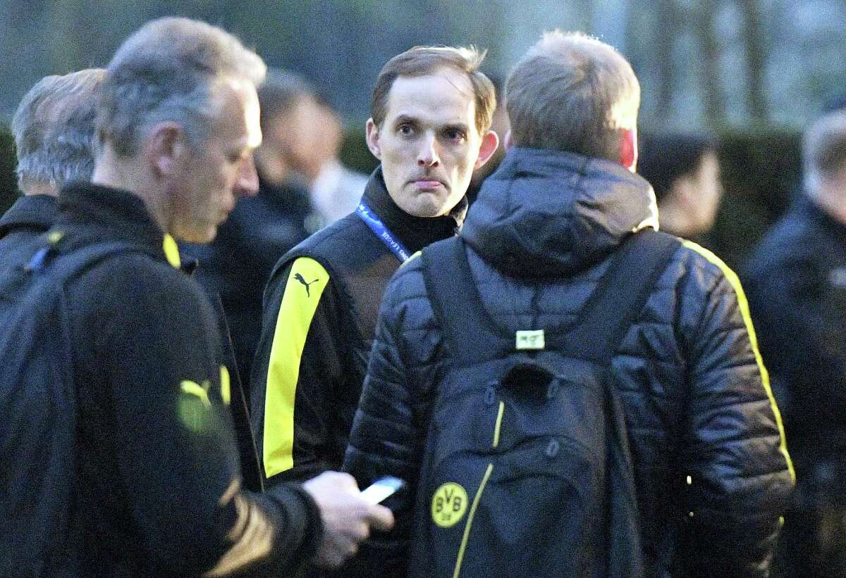 In this file photo Dortmund head coach Thomas Tuchel stands outside the team bus after it was damaged in an explosion.