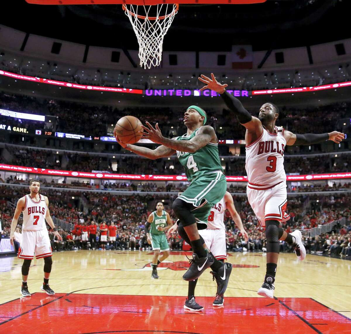 The Celtics' Isaiah Thomas, left, drives past the Bulls' Dwyane Wade in the second half Friday in Chicago.