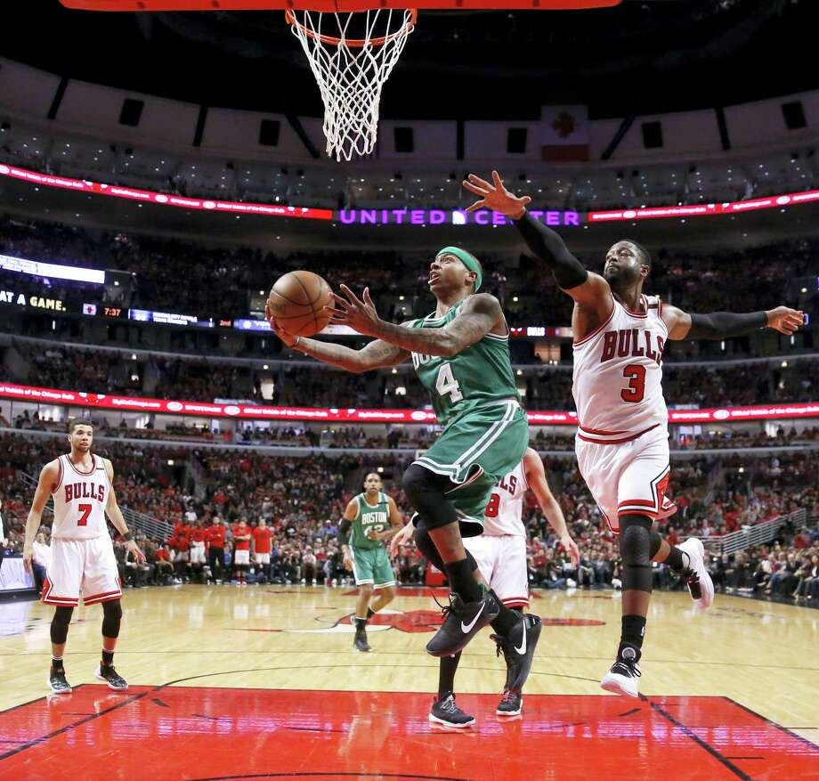The Celtics' Isaiah Thomas, left, drives past the Bulls' Dwyane Wade in the second half Friday in Chicago. Photo: Charles Rex Arbogast — The Associated Press  / Copyright 2017 The Associated Press. All rights reserved.