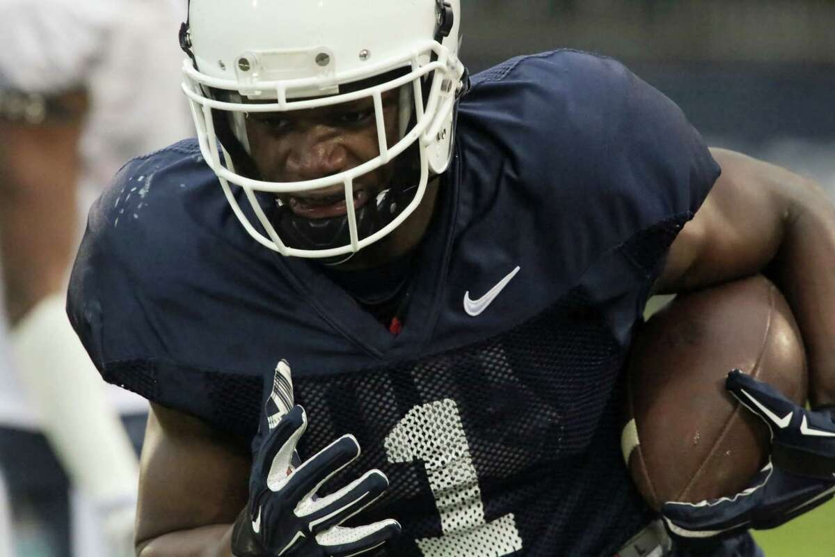 UConn's Hergy Mayala scores a touchdown during the first half Friday.