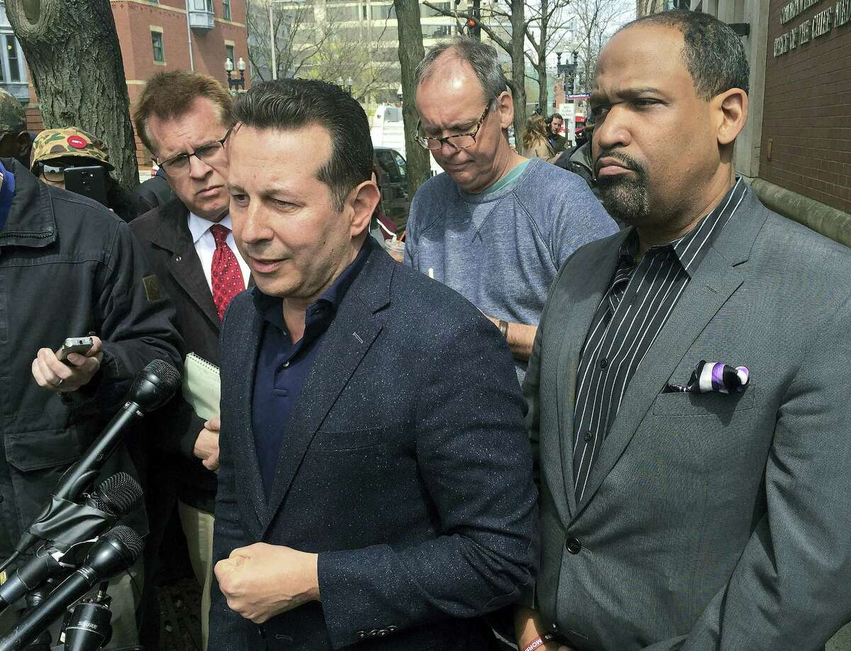 """Attorneys Jose Baez, left, and Ronald Sullivan, who successfully defended former New England Patriots player Aaron Hernandez in a double-murder case, hold a briefing outside the state medical examiner's office, Thursday, April 20, 2017, in Boston. Baez accused Massachusetts' chief medical examiner of """"illegally"""" holding the brain of the ex-NFL star, who was found Wednesday hanged in his prison cell. Baez said Hernandez's family had arranged for Boston University to study the former tight end's brain as part of its concussion research."""